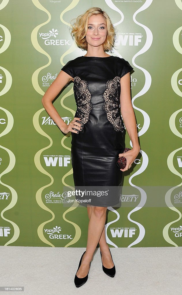 Actress Caitlin FitzGerald arrives at the Variety And Women In Film Pre-Emmy Party at Scarpetta on September 20, 2013 in Beverly Hills, California.