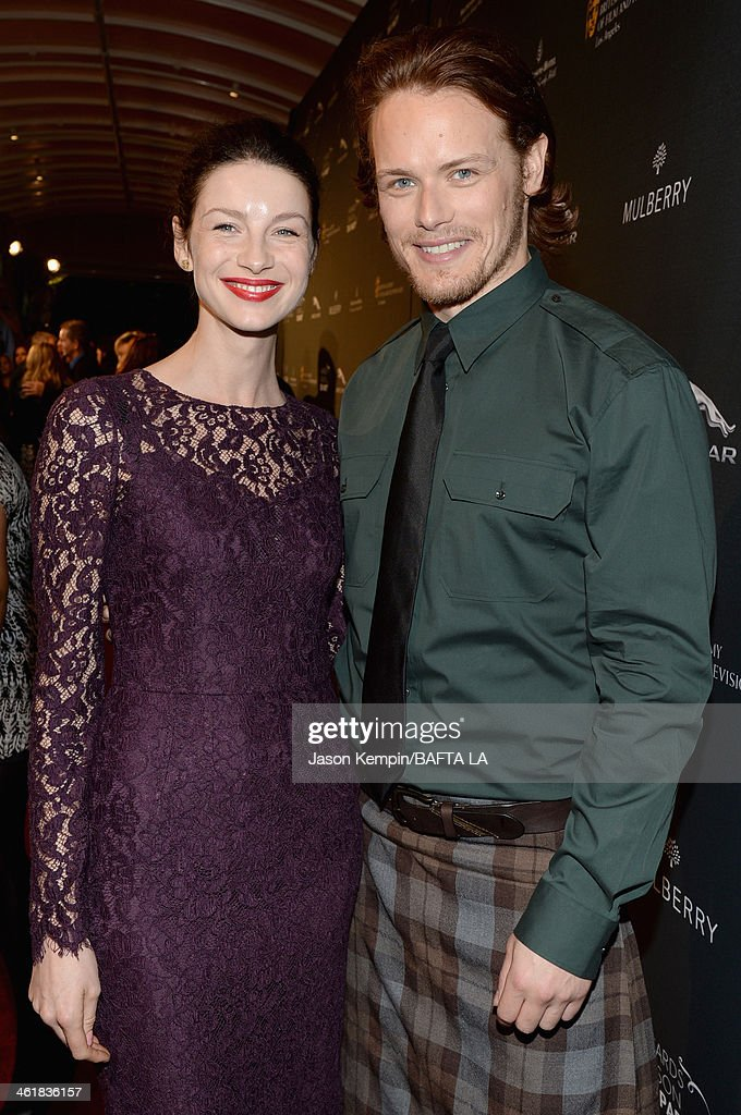 Actress <a gi-track='captionPersonalityLinkClicked' href=/galleries/search?phrase=Caitriona+Balfe&family=editorial&specificpeople=4359165 ng-click='$event.stopPropagation()'>Caitriona Balfe</a> (L) and actor <a gi-track='captionPersonalityLinkClicked' href=/galleries/search?phrase=Sam+Heughan&family=editorial&specificpeople=6931997 ng-click='$event.stopPropagation()'>Sam Heughan</a> attend the BAFTA LA 2014 Awards Season Tea Party at the Four Seasons Hotel Los Angeles at Beverly Hills on January 11, 2014 in Beverly Hills, California.