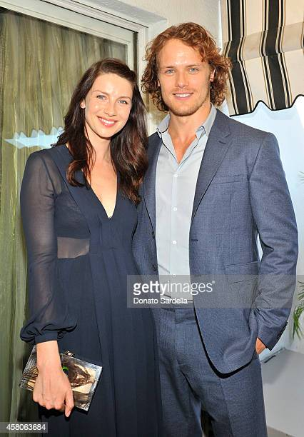 Actress Caitriona Balfe and actor Sam Heughan wearing Burberry at Eddie Redmayne Vanity Fair And Burberry Celebrate BAFTA Los Angeles and the...