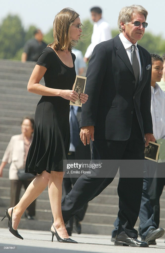 Actress Calista Flockhart and Actor <a gi-track='captionPersonalityLinkClicked' href=/galleries/search?phrase=Harrison+Ford+-+Actor+-+Born+1942&family=editorial&specificpeople=11508906 ng-click='$event.stopPropagation()'>Harrison Ford</a> after the Mass Memorial for actor Gregory Peck June 16, 2003 in Los Angeles, California. The public memorial mass was held a the Our Lady of Angels Cathedral in Downtown Los Angeles.
