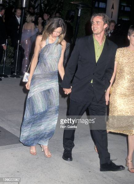 Actress Calista Flockhart and actor Sam Trammell attend the Eighth Annual Vanity Fair Oscar Party on March 25 2001 at Morton's Restaurant in West...