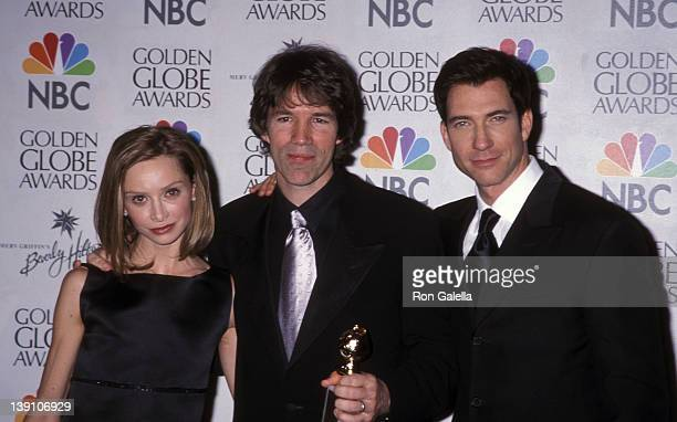 Actress Calista Flockhart writer/producer David E Kelley and actor Dylan McDermott attend the 56th Annual Golden Globe Awards on January 24 1999 at...