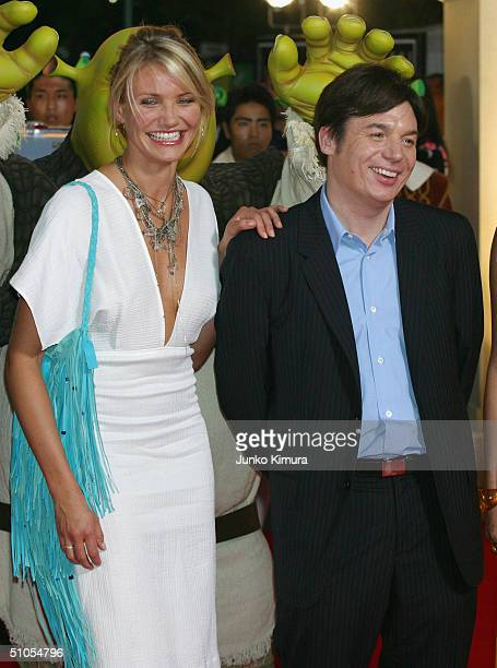 Actress Cameron Diaz and actor Mike Myers in high spirits as they promote 'Shrek 2' on July 13 2004 in Tokyo Japan The film opens on July 24 in Japan