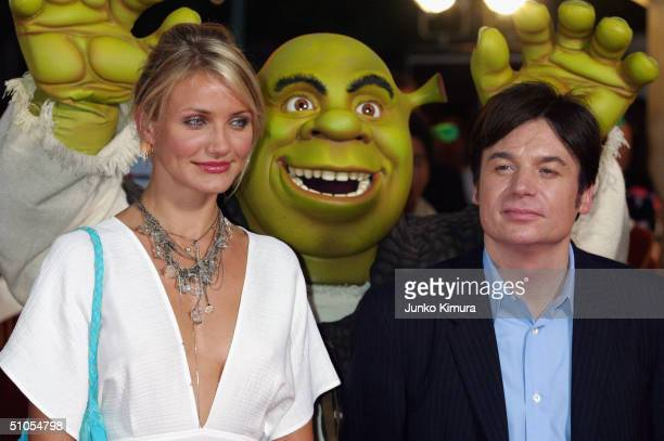 Actress Cameron Diaz and actor Mike Myers pose as they promote 'Shrek 2' on July 13 2004 in Tokyo Japan The film opens on July 24 in Japan