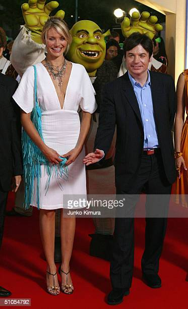 Actress Cameron Diaz and actor Mike Myers pose for photographers as they attend a redcarpet event to promote 'Shrek 2' on July 13 2004 in Tokyo Japan...