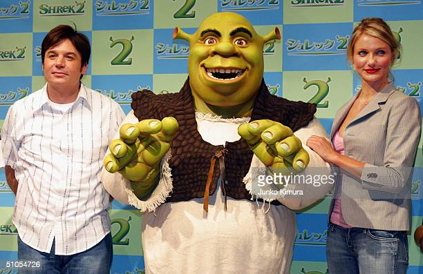 Actress Cameron Diaz and actor Mike Myers pose for photographers at a photo session during a press conference to promote 'Shrek 2' on July 13 2004 in...