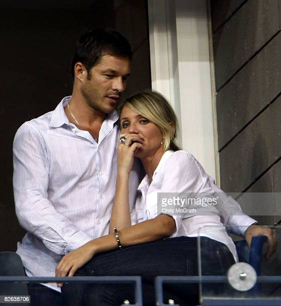 Actress Cameron Diaz and Paul Sculfor attend the match between Andy Roddick of the United States and Fernando Gonzalez of Chile during Day 9 of the...