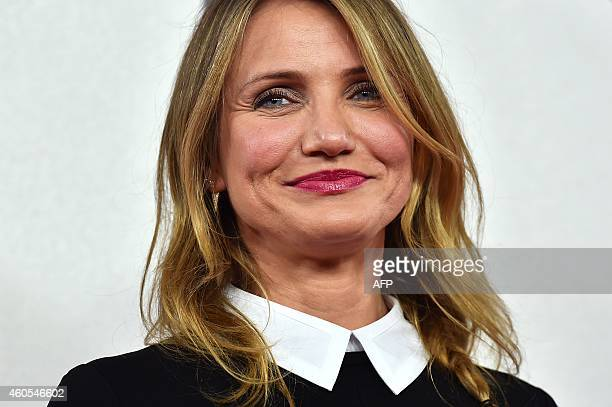 US actress Cameron Diaz poses for pictures during a photocall for the film 'Annie' in central London on December 16 2014 AFP PHOTO / BEN STANSALL