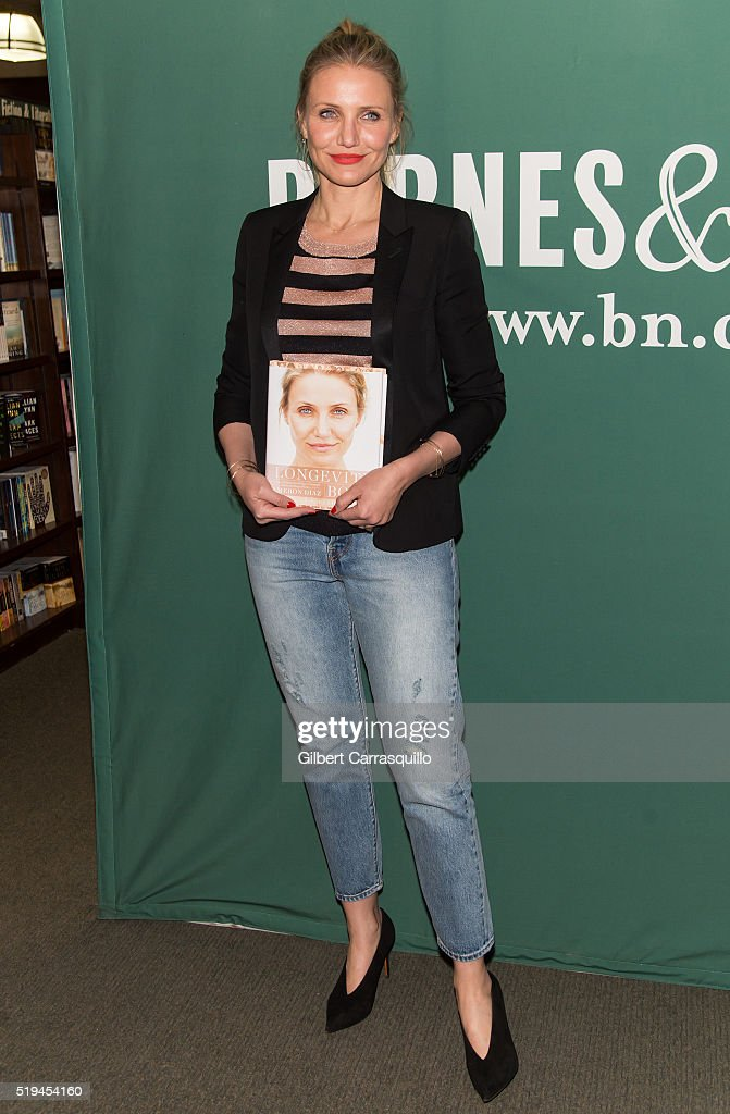 Actress Cameron Diaz poses with her new book 'The Longevity Book: The Science of Aging, the Biology of Strength, and the Privilege of Time' at Barnes & Noble Union Square on April 6, 2016 in New York City.