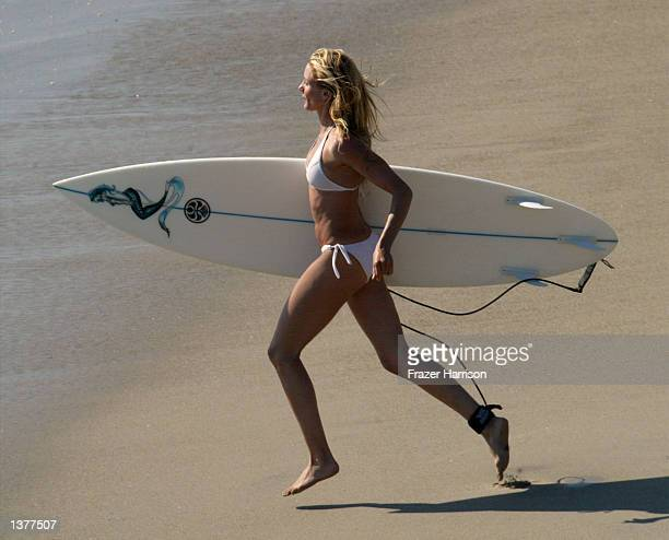 Actress Cameron Diaz prepares to surf on the set of her upcoming movie 'Charlie's Angels 2' on September 10 2002 in Malibu California