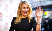 US actress Cameron Diaz waves as she poses on the red carpet before the premiere of the film 'The Other Woman' at the Tuschinski Theater in Amsterdam...