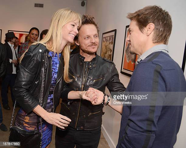 Actress Cameron Richardson photographer Randall Slavin and actor Jeremy Renner attend the opening of 'Wetdreams' at Gallery Brown on December 6 2012...