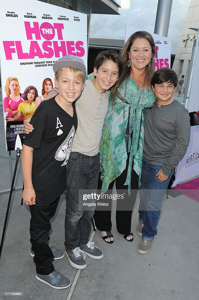 Actress Camryn Manheim and her son Milo (R) arrive at the premiere of 'The Hot Flashes' at ArcLight Cinemas on June 27, 2013 in Hollywood, California.