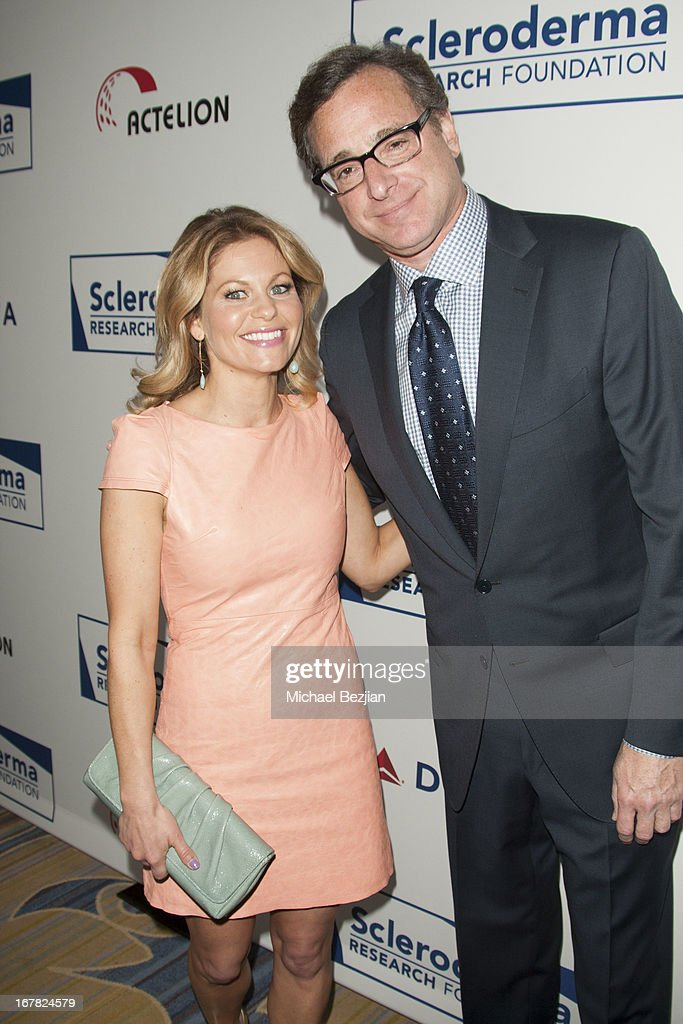 Actress <a gi-track='captionPersonalityLinkClicked' href=/galleries/search?phrase=Candace+Cameron+Bure&family=editorial&specificpeople=699962 ng-click='$event.stopPropagation()'>Candace Cameron Bure</a> and actor/comedian <a gi-track='captionPersonalityLinkClicked' href=/galleries/search?phrase=Bob+Saget&family=editorial&specificpeople=209388 ng-click='$event.stopPropagation()'>Bob Saget</a> walk the red carpet at Scleroderma Research Foundation's Cool Comedy - Hot Cuisine at Regent Beverly Wilshire Hotel on April 30, 2013 in Beverly Hills, California.