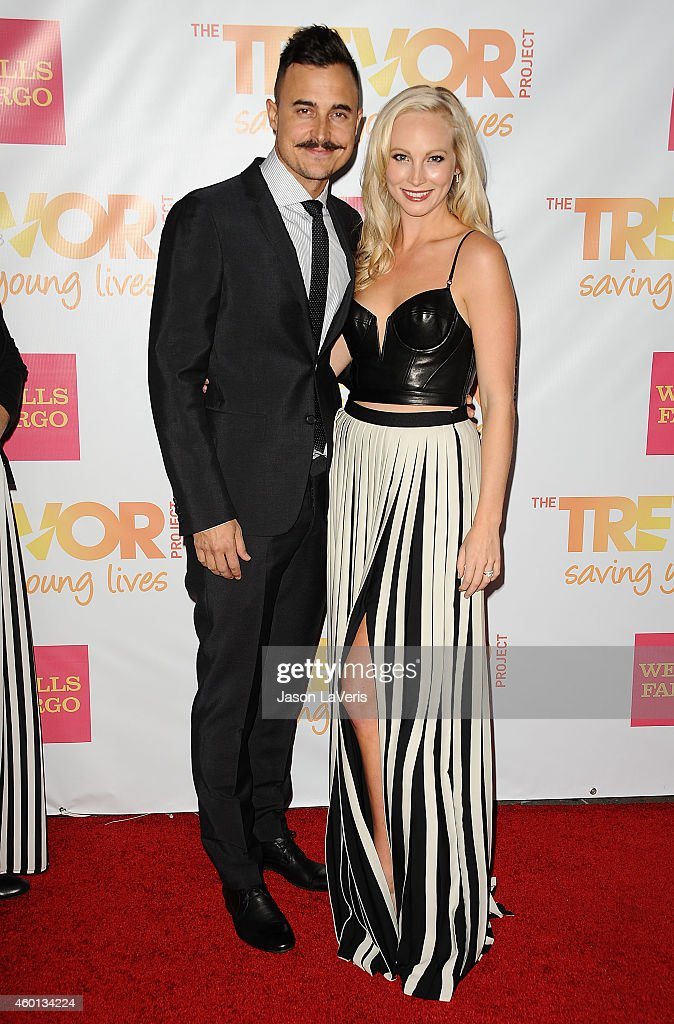 Actress Candice Accola and husband Joe King attend TrevorLIVE Los Angeles at the Hollywood Palladium on December 7 2014 in Los Angeles California