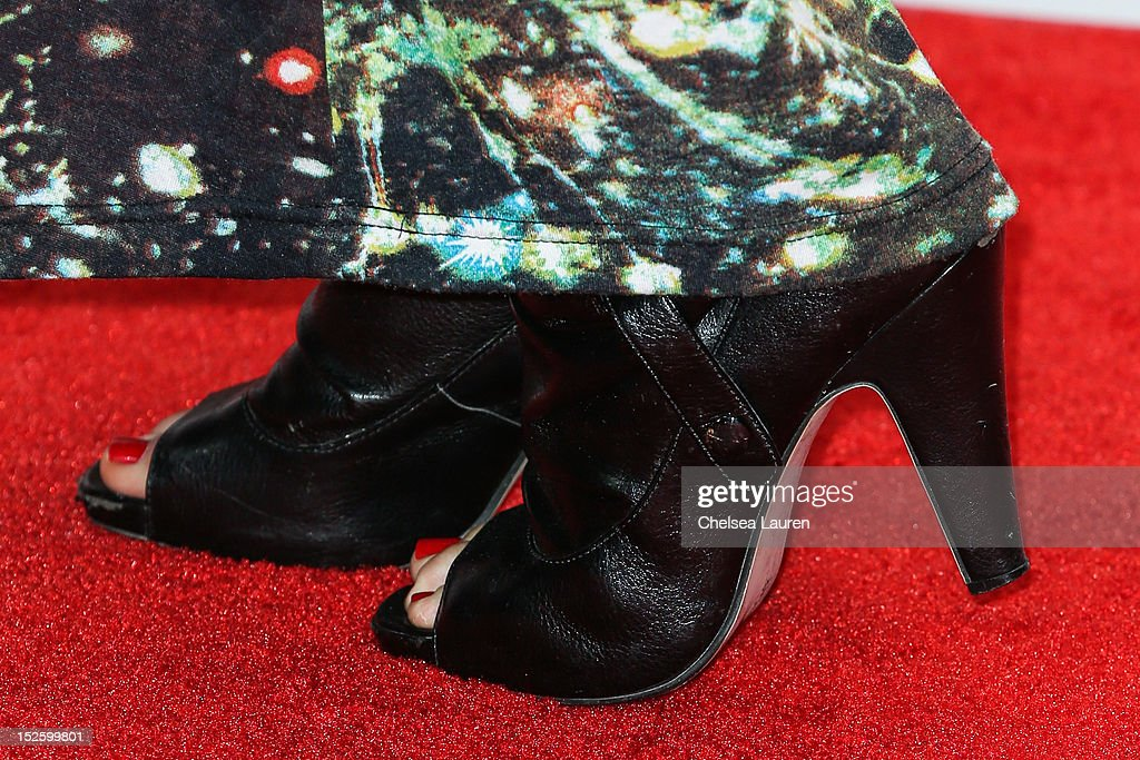 Actress Candice Accola (shoe detail) arrives at iHeartRadio Music Festival press room at MGM Grand Garden Arena on September 22, 2012 in Las Vegas, Nevada.
