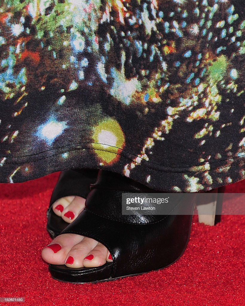 Actress Candice Accola (shoes detail) poses in the press room at the iHeartRadio Music Festival at the MGM Grand Garden Arena September 21, 2012 in Las Vegas, Nevada.