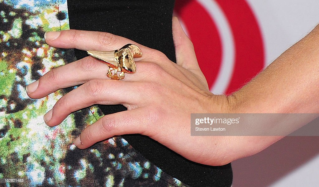 Actress Candice Accola (jewlery detail) poses in the press room at the iHeartRadio Music Festival at the MGM Grand Garden Arena September 21, 2012 in Las Vegas, Nevada.