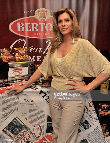 Actress Candis Cayne attends the Bertolli Oven Bake Meals at the Access Hollywood 'Stuff You Must' Lounge produced by On 3 Productions held at...
