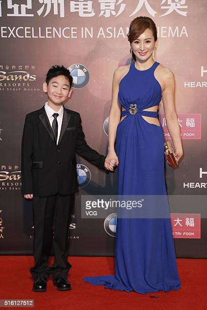 Actress Candy Law and her son attend the 10th Asian Film Awards at the Venetian Theatre on March 17 2016 in Macau China