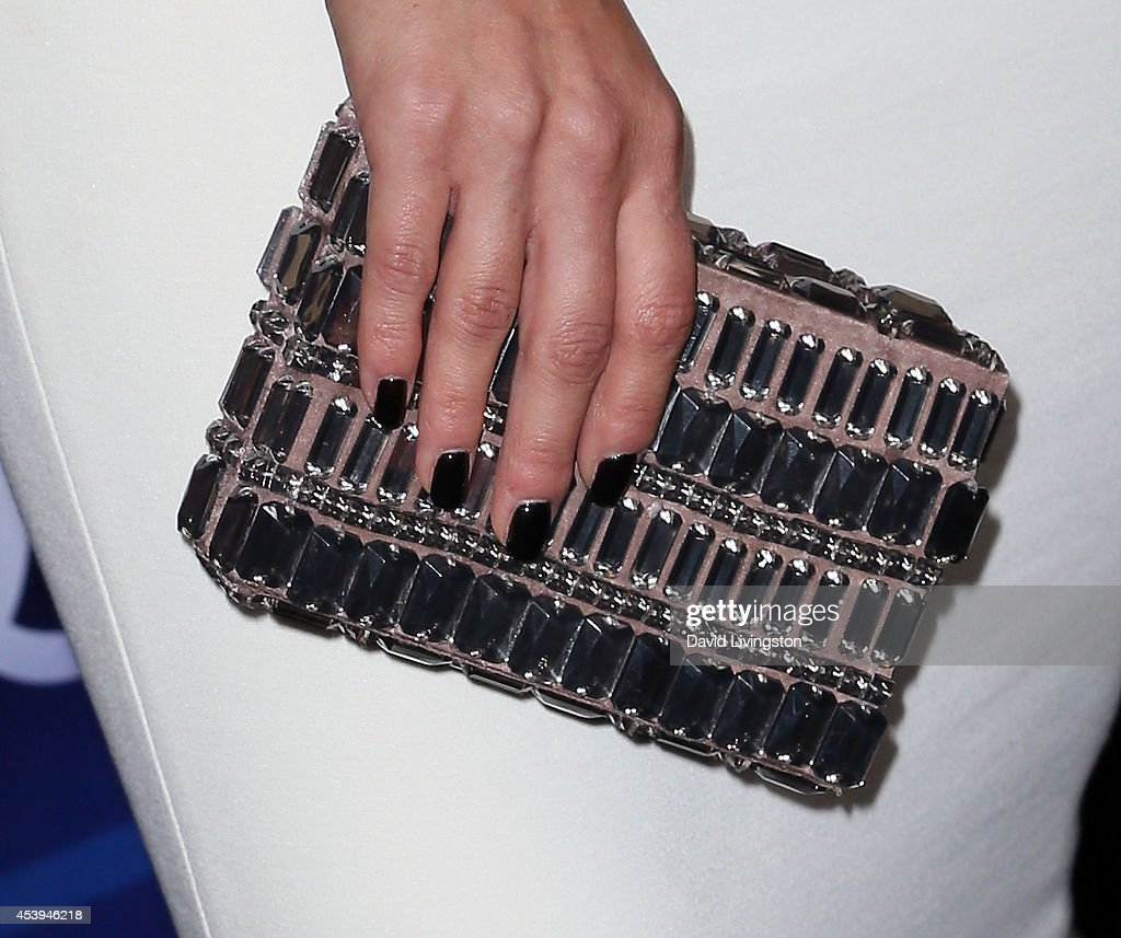 Actress Cara Santana (purse detail) attends the Audi celebration of Emmys Week 2014 at Cecconi's Restaurant on August 21, 2014 in Los Angeles, California.