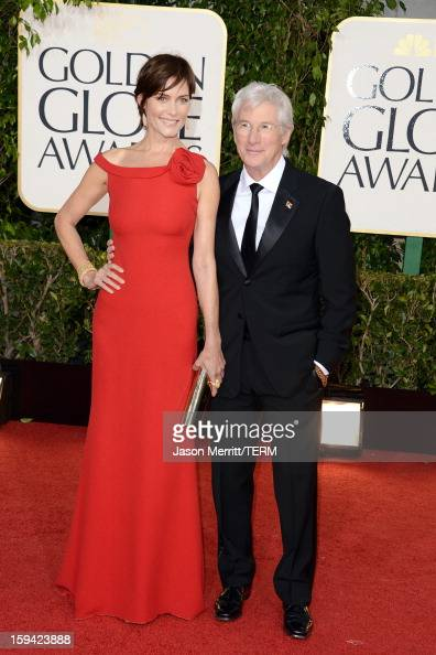 Actress Carey Lowell and actor Richard Gere arrive at the 70th Annual Golden Globe Awards held at The Beverly Hilton Hotel on January 13 2013 in...