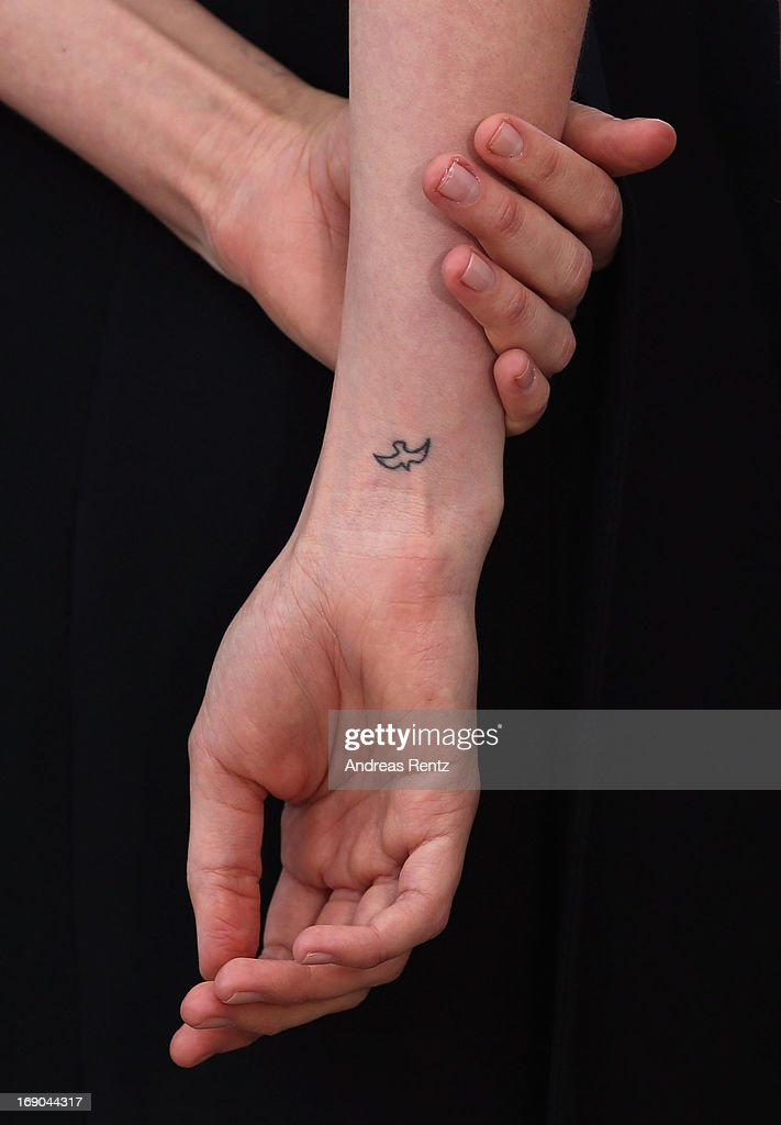 Actress Carey Mulligan (tatoo detail) attends the 'Inside Llewyn Davis' photocall during the 66th Annual Cannes Film Festival at the Palais des Festivals on May 19, 2013 in Cannes, France.