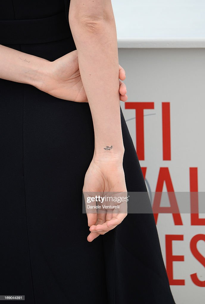Actress Carey Mulligan (tattoo detail) attends the photocall for 'Inside Llewyn Davis' during the 66th Annual Cannes Film Festival at Palais des Festivals on May 19, 2013 in Cannes, France.