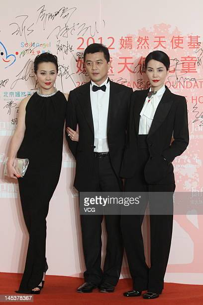 Actress Carina Lau actor Li Yapeng and singer Faye Wong attend the Yanran Angel Foundation charity dinner at China World Summit Wing on May 27 2012...