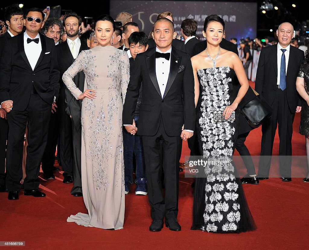 Actress <a gi-track='captionPersonalityLinkClicked' href=/galleries/search?phrase=Carina+Lau&family=editorial&specificpeople=663580 ng-click='$event.stopPropagation()'>Carina Lau</a>, actor <a gi-track='captionPersonalityLinkClicked' href=/galleries/search?phrase=Tony+Leung+Chiu-Wai&family=editorial&specificpeople=6918807 ng-click='$event.stopPropagation()'>Tony Leung Chiu-Wai</a> and actress Zhang Ziyi arrive on the red carpet of the 50th Golden Horse Awards at Sun Yat-sen Memorial Hall on November 23, 2013 in Taipei, Taiwan.