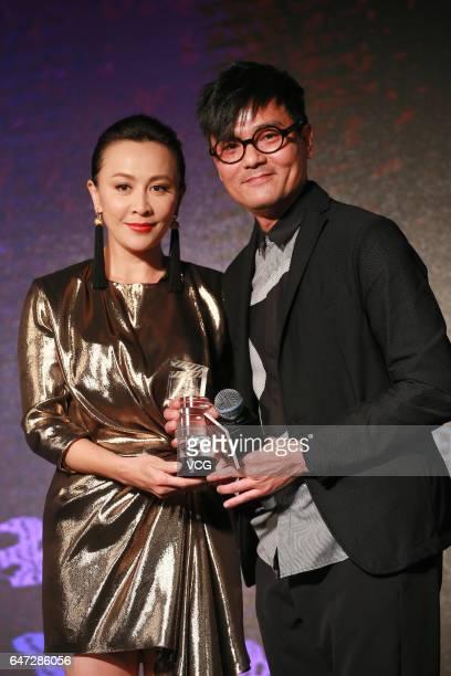 Actress Carina Lau and actor Lam Ka Tung pose during Hong Kong Film Directors' Guild Award Ceremony on March 2 2017 in Hong Kong China
