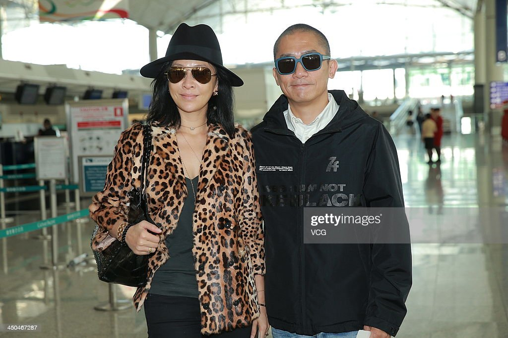 Actress <a gi-track='captionPersonalityLinkClicked' href=/galleries/search?phrase=Carina+Lau&family=editorial&specificpeople=663580 ng-click='$event.stopPropagation()'>Carina Lau</a> and her husband Tony Leung Chiu-Wai arrive at Hong Kong airport ahead of Chang Chen's wedding ceremony on November 18, 2013 in Hong Kong, Hong Kong.