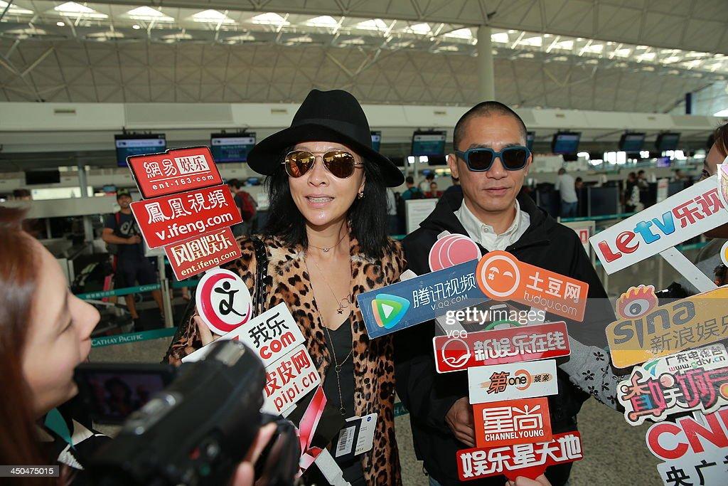 Actress Carina Lau and her husband Tony Leung Chiu-Wai arrive at Hong Kong airport ahead of Chang Chen's wedding ceremony on November 18, 2013 in Hong Kong, Hong Kong.