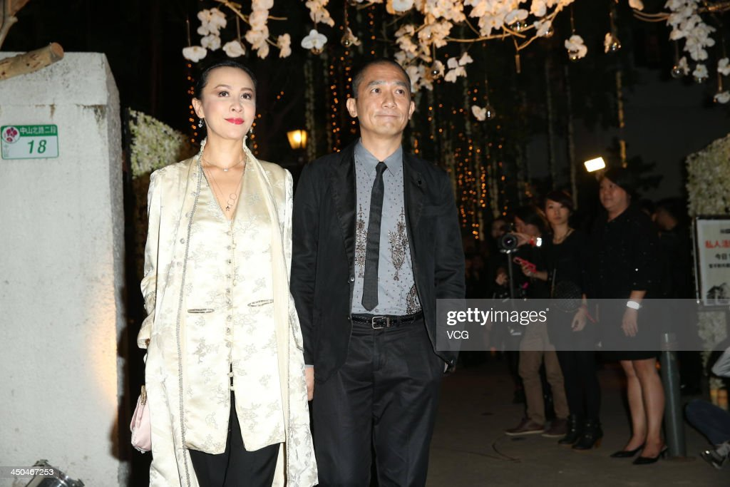 Actress <a gi-track='captionPersonalityLinkClicked' href=/galleries/search?phrase=Carina+Lau&family=editorial&specificpeople=663580 ng-click='$event.stopPropagation()'>Carina Lau</a> and her husband <a gi-track='captionPersonalityLinkClicked' href=/galleries/search?phrase=Tony+Leung+Chiu-Wai&family=editorial&specificpeople=6918807 ng-click='$event.stopPropagation()'>Tony Leung Chiu-Wai</a> attend Chang Chen's wedding ceremony on November 18, 2013 in Taipei, Taiwan.