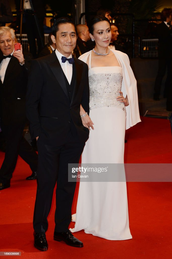 Actress <a gi-track='captionPersonalityLinkClicked' href=/galleries/search?phrase=Carina+Lau&family=editorial&specificpeople=663580 ng-click='$event.stopPropagation()'>Carina Lau</a> (R) and Tony Leung Chiu Wai attend the 'Soshite Chichi Ni Naru' Premiere during the 66th Annual Cannes Film Festival at the Palais des Festivals on May 18, 2013 in Cannes, France.