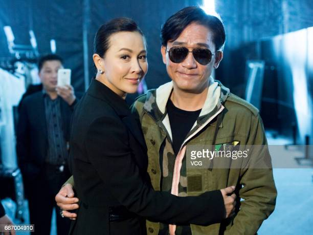Actress Carina Lau Karling and her husband actor Tony Leung Chiuwai attend ANIRAC collection by Carina Lau during the Shanghai Fashion Week...
