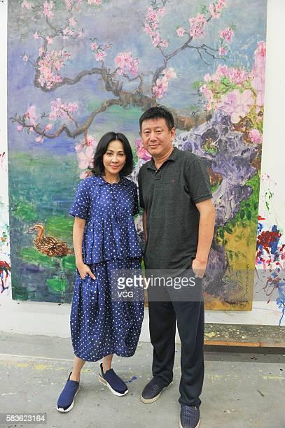 Actress Carina Lau visits painter Zhou Chunya at Chengdu Blueroof Art Gallery on July 26 2016 in Chengdu Sichuan Province of China