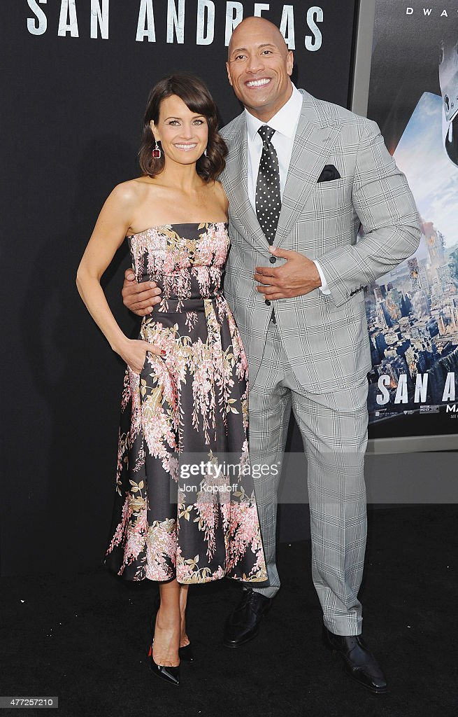 Actress Carla Gugino and actor Dwayne 'The Rock' Johnson arrive at the Premiere Of Warner Bros. Pictures' 'San Andreas' at TCL Chinese Theatre on May 26, 2015 in Hollywood, California.