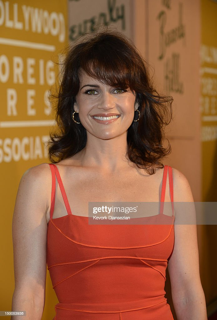 Actress Carla Gugino arrives at the Hollywood Foreign Press Association's 2012 Installation Luncheon held at the Beverly Hills Hotel on August 9, 2012 in Beverly Hills, California.
