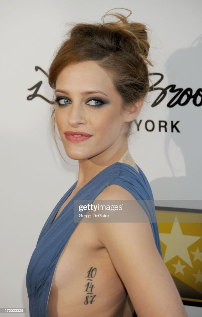 Actress <a gi-track='captionPersonalityLinkClicked' href=/galleries/search?phrase=Carly+Chaikin&family=editorial&specificpeople=6249538 ng-click='$event.stopPropagation()'>Carly Chaikin</a> arrives at the Broadcast Television Journalists Association 3rd Annual Critics' Choice Television Awards at The Beverly Hilton Hotel on June 10, 2013 in Beverly Hills, California.