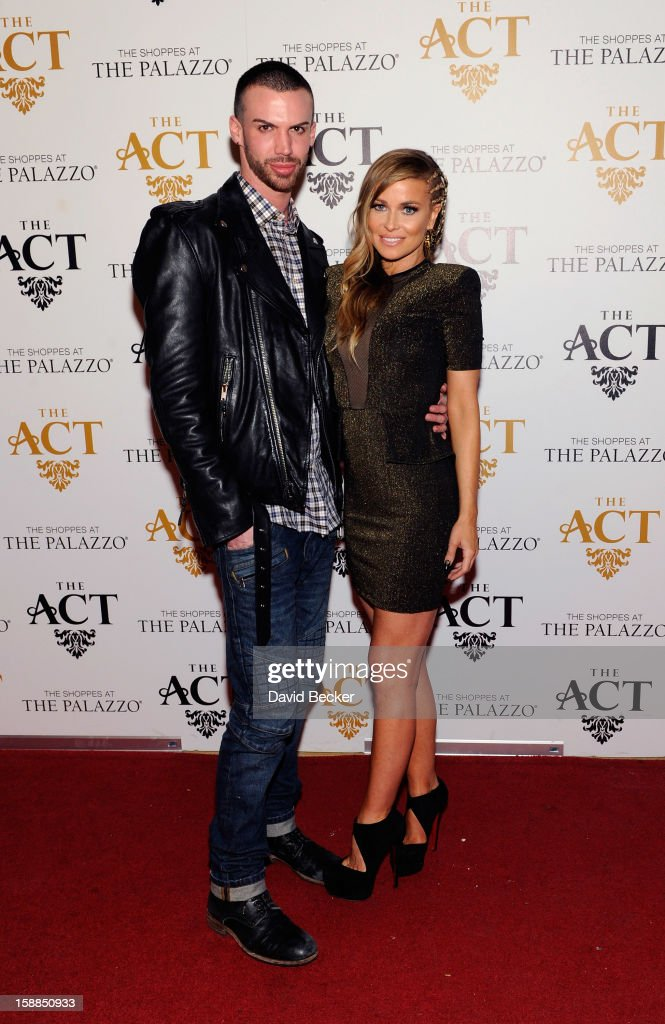 Actress Carmen Electra (R) and Mikey Minden arrive at the New Year's Eve celebration at The Act at The Palazzo on December 31, 2012 in Las Vegas, Nevada.