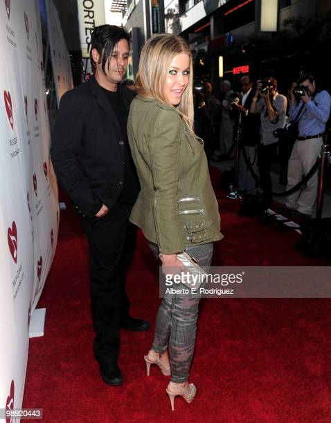 Actress Carmen Electra and musician Rob Patterson arrive at the 6th Annual MusiCares MAP Fund Benefit Concert at Club Nokia on May 7 2010 in Los...