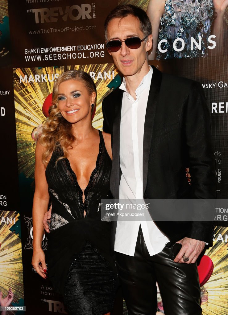 Actress <a gi-track='captionPersonalityLinkClicked' href=/galleries/search?phrase=Carmen+Electra&family=editorial&specificpeople=171242 ng-click='$event.stopPropagation()'>Carmen Electra</a> (L) and photographer Markus Klinko attend the Markus + Indrani ICONS Book Launch Party at Merry Karnowsky Gallery on January 10, 2013 in Los Angeles, California.