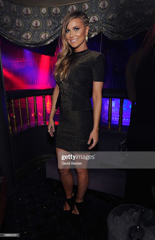 Actress <a gi-track='captionPersonalityLinkClicked' href=/galleries/search?phrase=Carmen+Electra&family=editorial&specificpeople=171242 ng-click='$event.stopPropagation()'>Carmen Electra</a> appears at the New Year's Eve celebration at The Act at The Palazzo on December 31, 2012 in Las Vegas, Nevada.