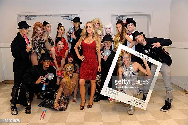 Actress Carmen Electra appears with Cirque du Soleil performers backstage at the Light Nightclub at the Mandalay Bay Resort and Casino on November 21...