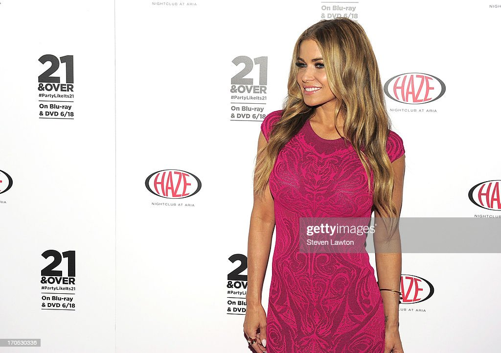 Actress <a gi-track='captionPersonalityLinkClicked' href=/galleries/search?phrase=Carmen+Electra&family=editorial&specificpeople=171242 ng-click='$event.stopPropagation()'>Carmen Electra</a> arrives at the '21 & Over' DVD release party at Haze Nightclub at the Aria Resort & Casino at CityCenter on June 13, 2013 in Las Vegas, Nevada.