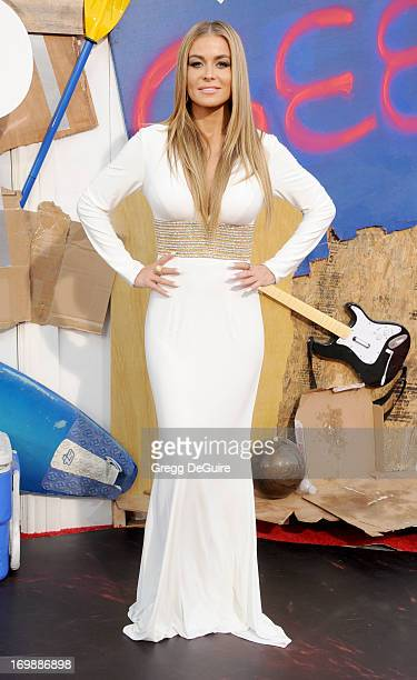 Actress Carmen Electra arrives at the Los Angeles premiere of 'This Is The End' at Regency Village Theatre on June 3 2013 in Westwood California