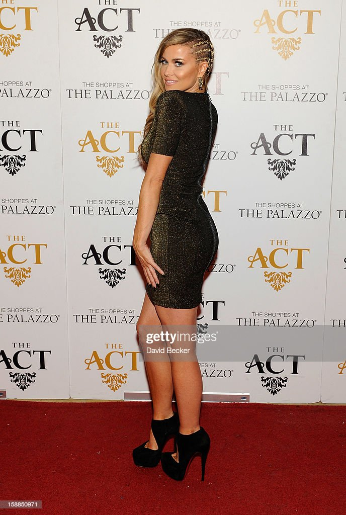 Actress <a gi-track='captionPersonalityLinkClicked' href=/galleries/search?phrase=Carmen+Electra&family=editorial&specificpeople=171242 ng-click='$event.stopPropagation()'>Carmen Electra</a> arrives at the New Year's Eve celebration at The Act at The Palazzo on December 31, 2012 in Las Vegas, Nevada.