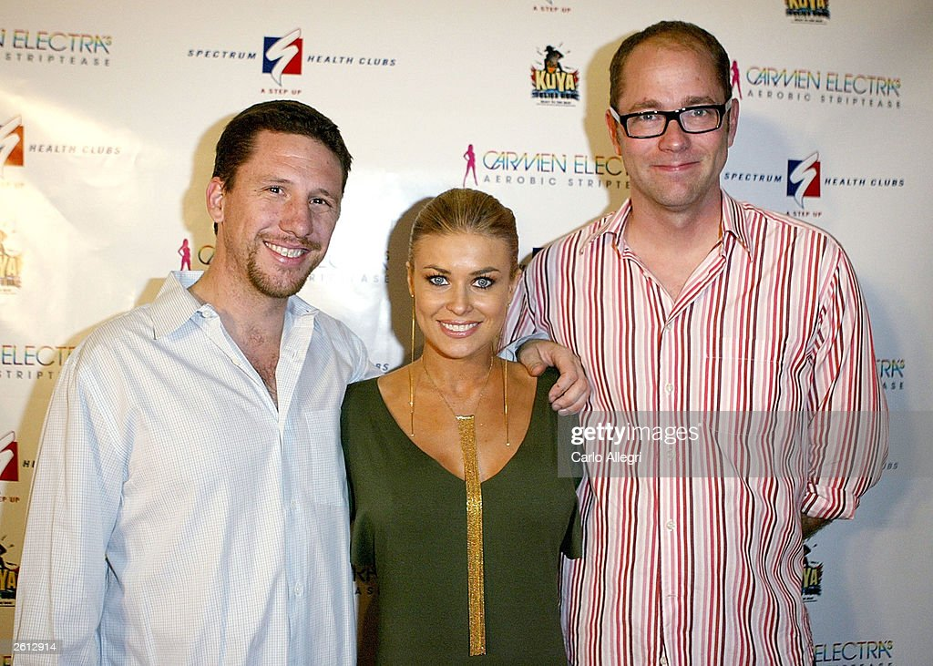 Actress Carmen Electra (C) Executive Producer Will Hobbs (L) and DNA Studio COO Chris Gibbin (r) arrive for Carmen Electra's Aerobic Striptease DVD Launch Party October 17, 2003 in Santa Monica, California.