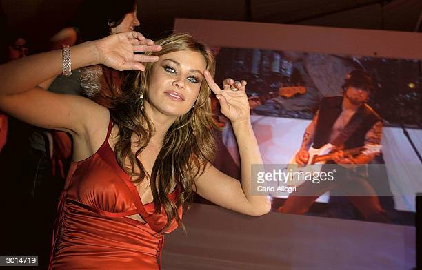 Actress Carmen Electra gestures as she arrives for the 3rd Annual 'ten' fashion show and charity event to celebrate awards season and car culture...